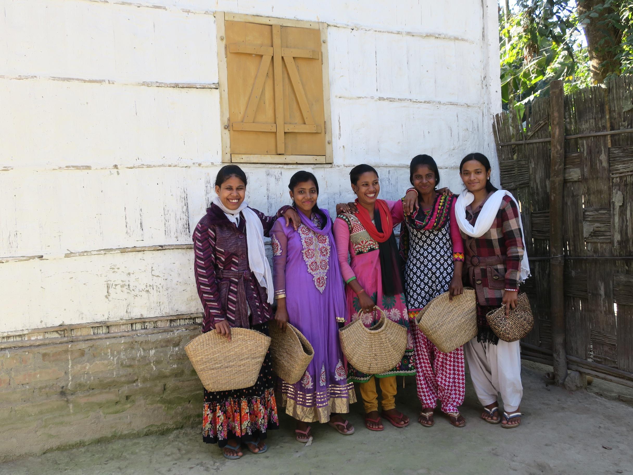 artisans modeling baskets