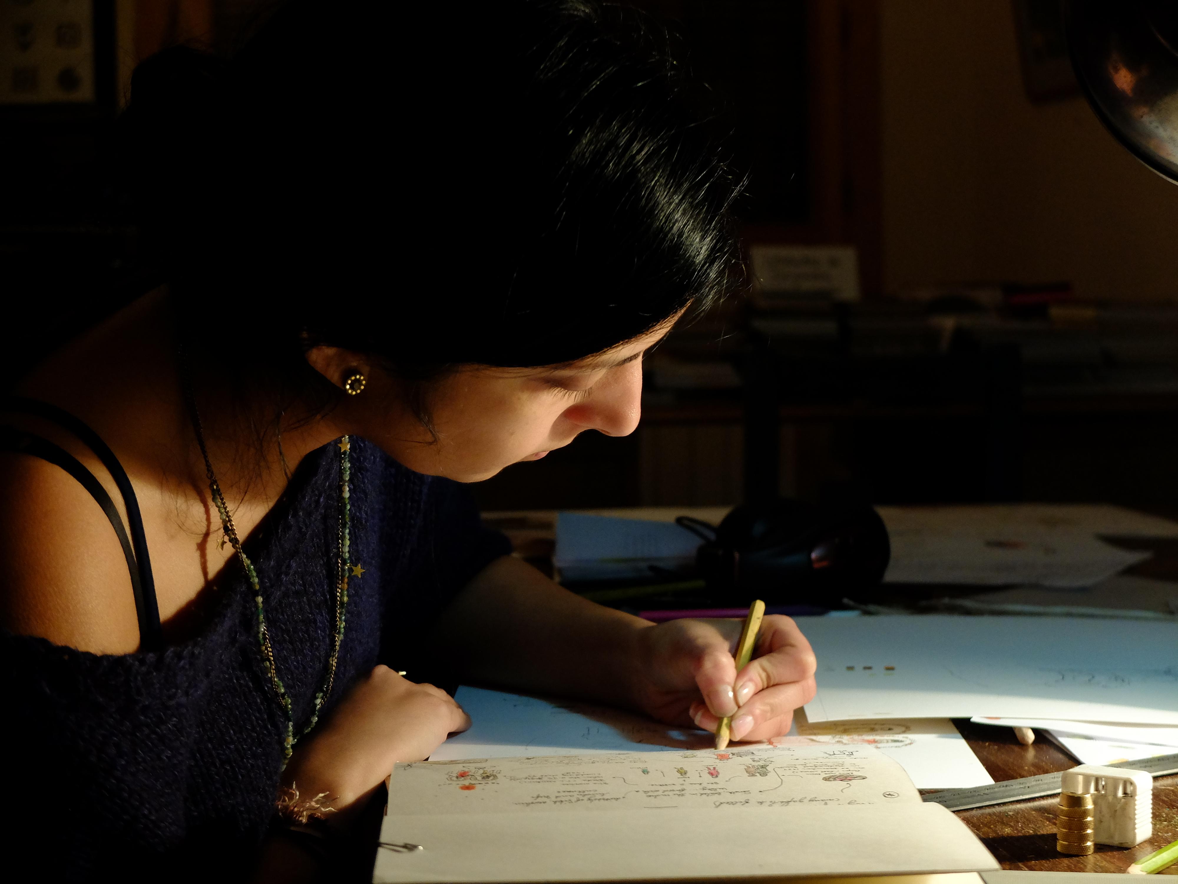 Karishma draws on paper