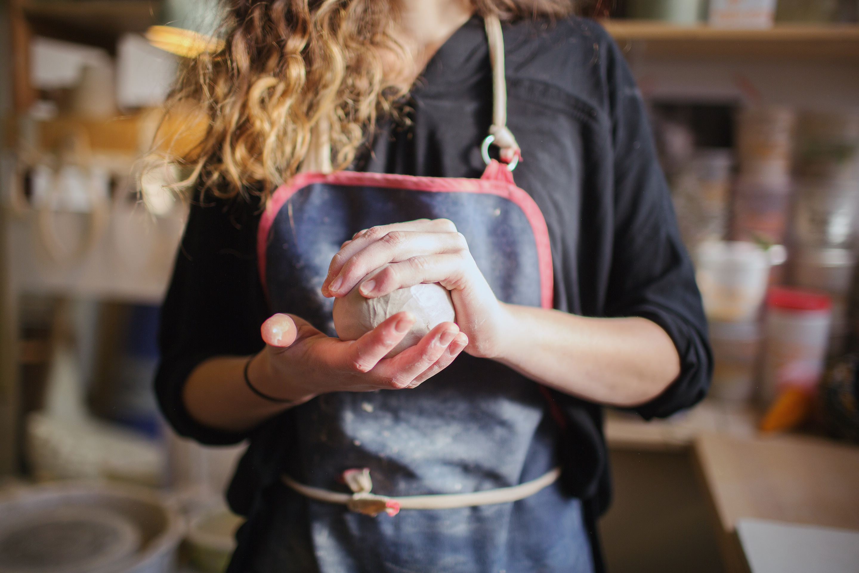 woman holding ceramic clay ball