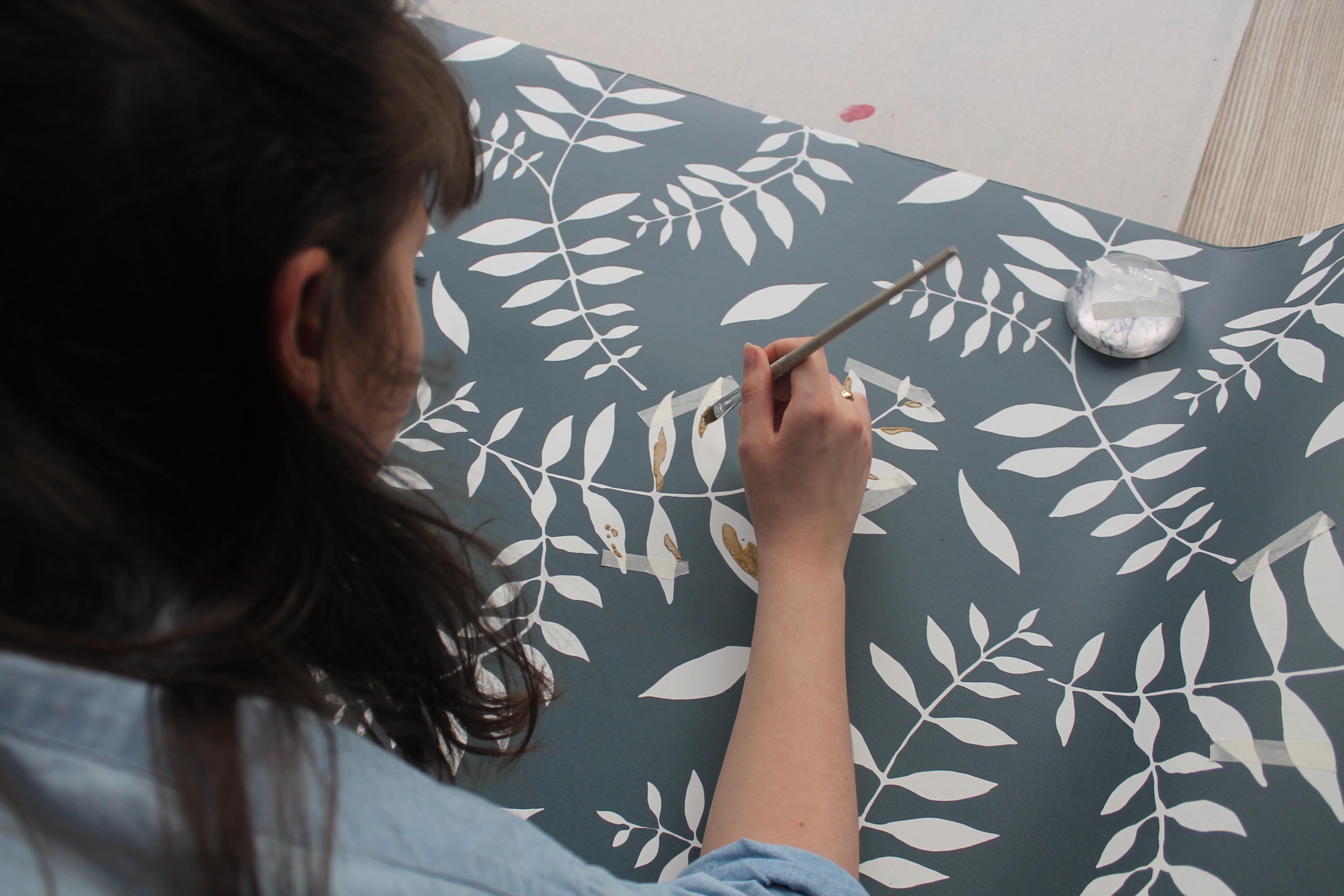 Melissa draws on wallpaper